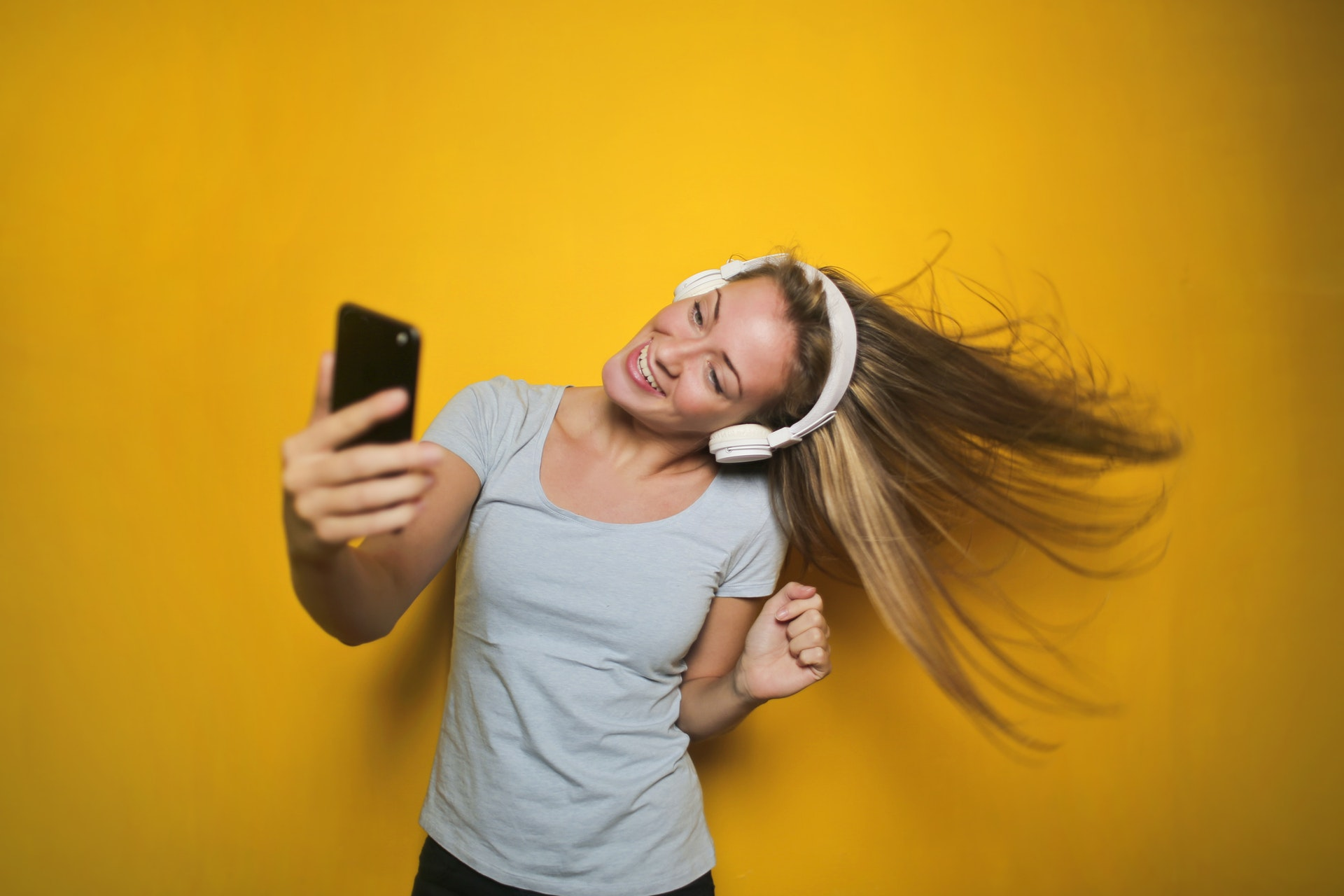 Girl enjoying portable music with headphones on