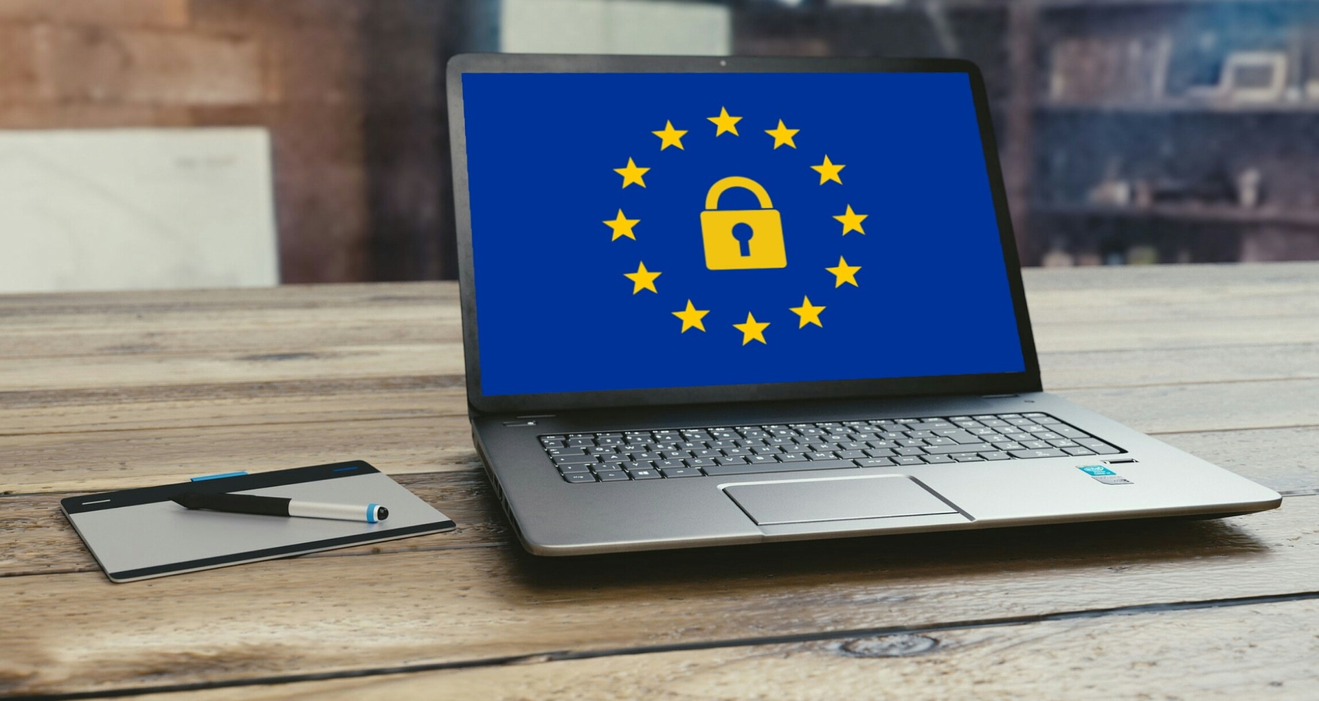 Laptop on desk with GDPR background image